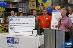 Benchmark owners present United Way of East Central Iowa with a check.